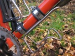 Blackburn stainless cages - If you've not got the mounts then Jubilee clips!